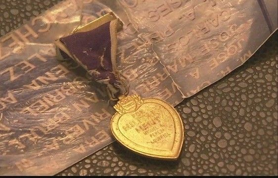 Purple Heart spotted on airport baggage claim belt finds its family